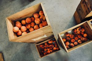 Bird's eye view of wooden crates filled with peaches stacked on top of one another